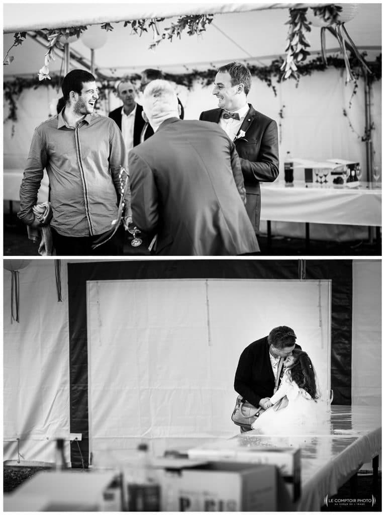 rire entre invités et geste de tendresse entre grand mère et petite fille - Mariage-Carolina-Fabien-Manoir-de-Chantilly_Gouvieux_Photographe-mariage-Oise_photographe-oise_Le-Comptoir-Photo